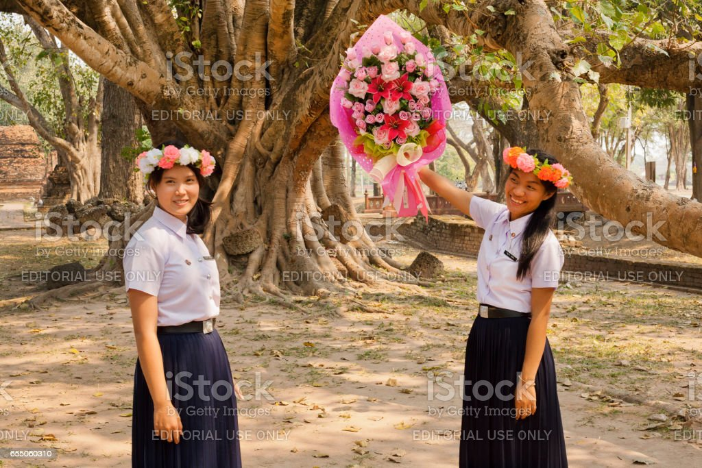 Beautiful Thai girls with flower wreath preparing for national holiday stock photo