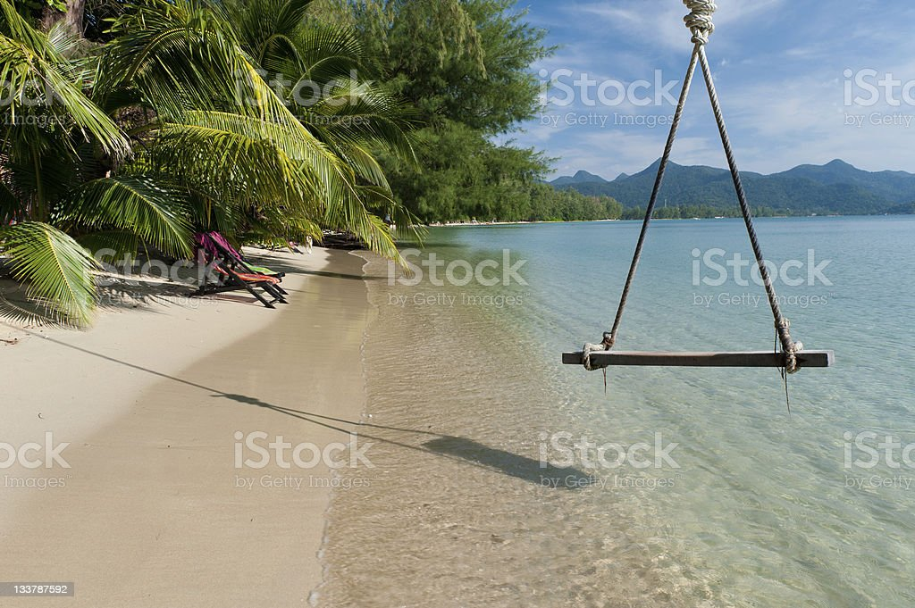 Beautiful Thailand beach with the swing stock photo