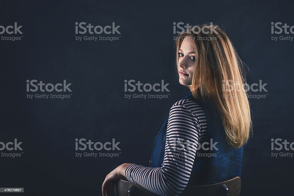 beautiful thoughtful girl close up in the dark royalty-free stock photo