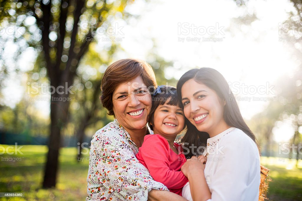 Beautiful three generation family stock photo