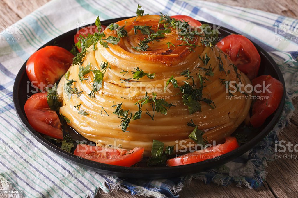 Beautiful timbale of pasta with cheese and vegetables close-up stock photo