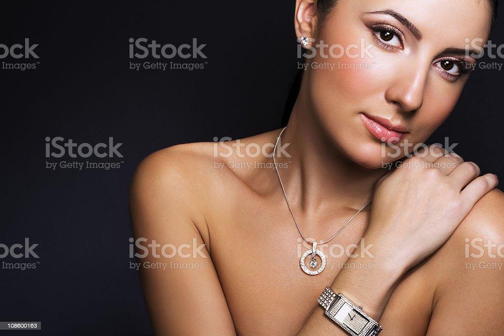 Beautiful topless woman modeling a silver wrist watch royalty-free stock photo