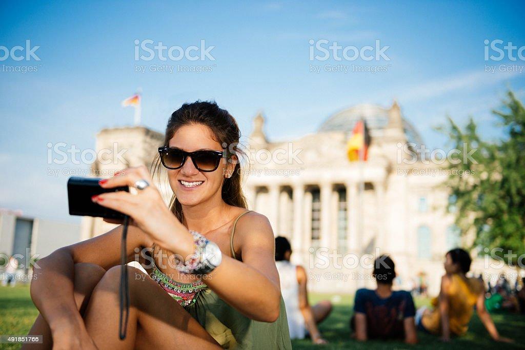 Beautiful tourist taking selfie with camera near Bundestag in Berlin stock photo
