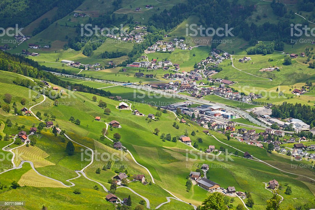 Beautiful town in a valley of the Alps in Switzerland stock photo