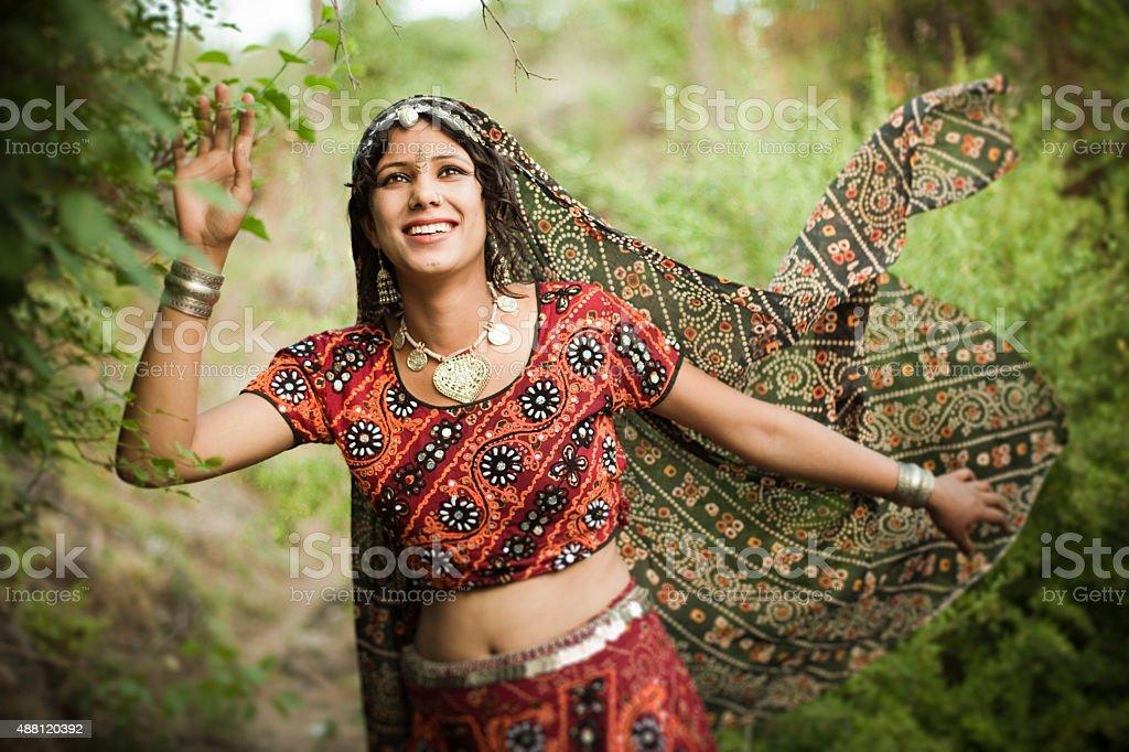 Beautiful, traditional, happy woman of rural India enjoying nature. stock photo