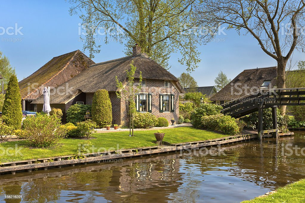 Beautiful traditional house with a thatched roof royalty-free stock photo