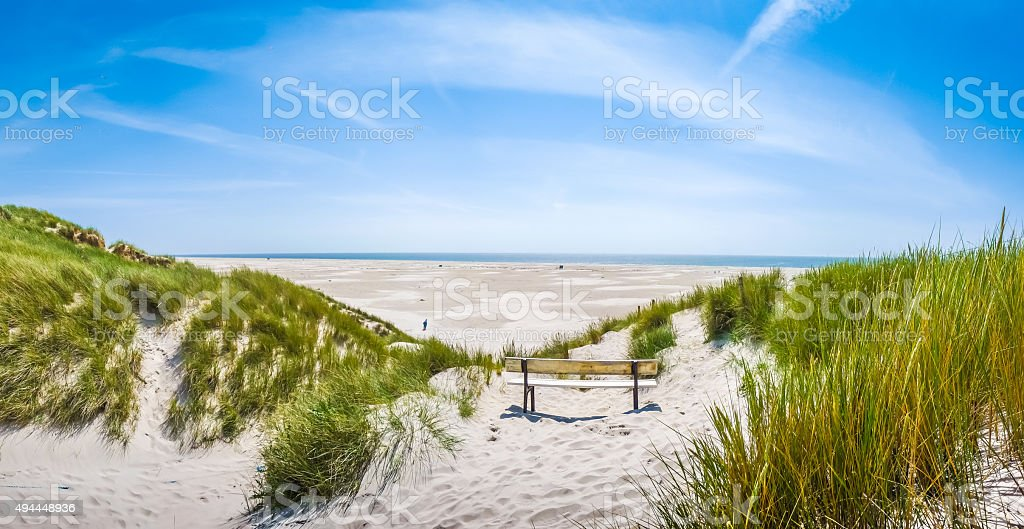 Beautiful tranquil dune landscape and long beach at North Sea stock photo