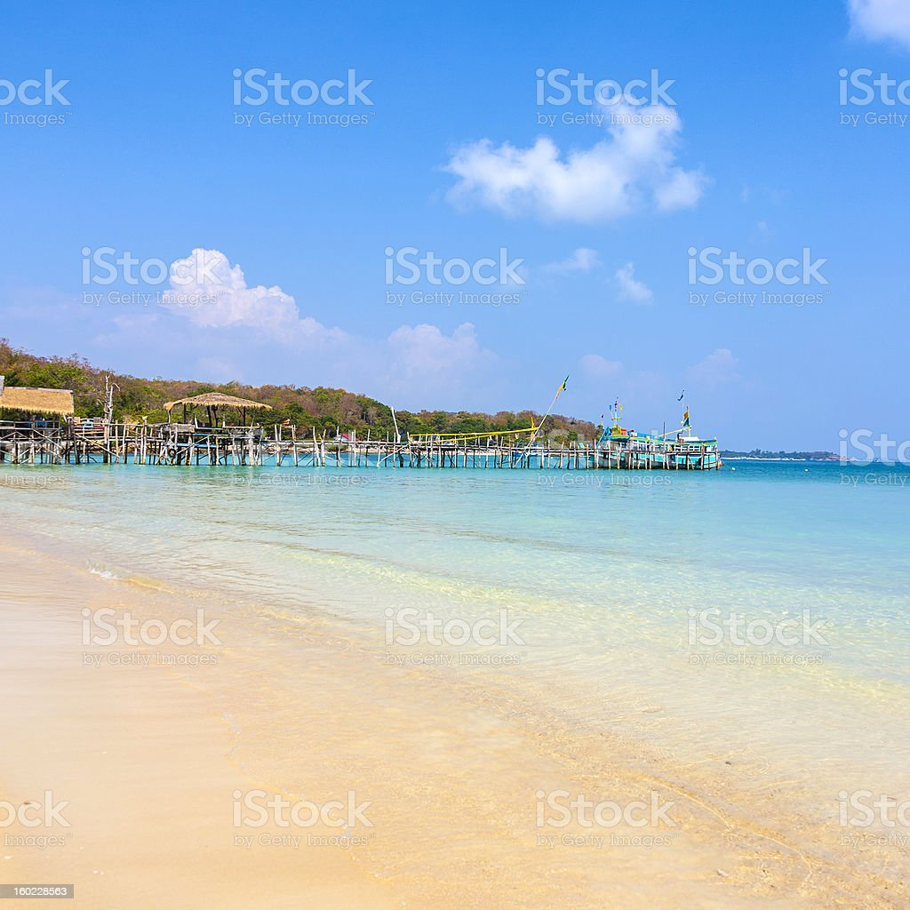 beautiful tropical beach on a Thai island with wooden pier royalty-free stock photo
