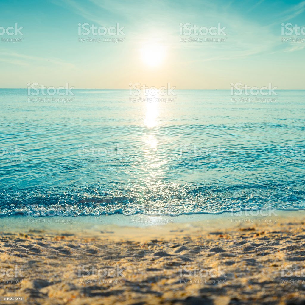 Beautiful tropical sand beach against the blue sky. stock photo