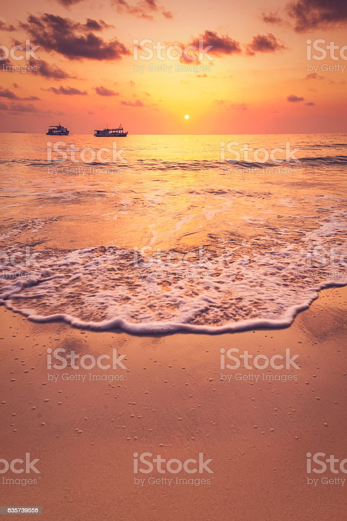 Beautiful tropical sunrise on the beach. stock photo