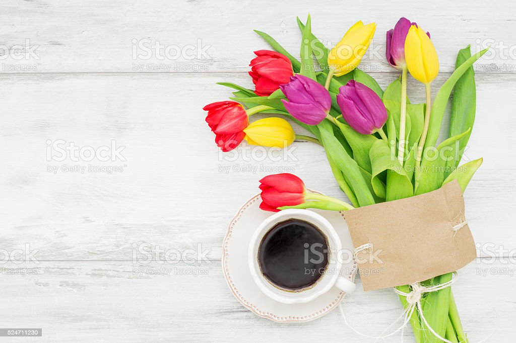 Beautiful tulips with card and coffee stock photo