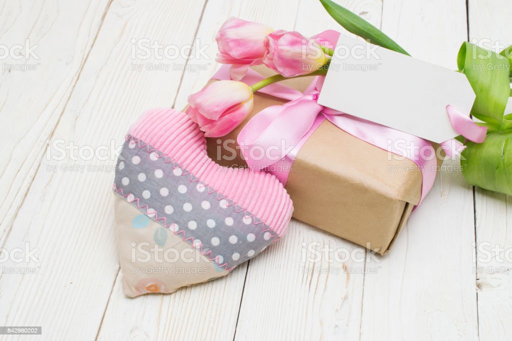 beautiful tulips with gift box. happy mothers day, romantic still life, fresh flowers. stock photo