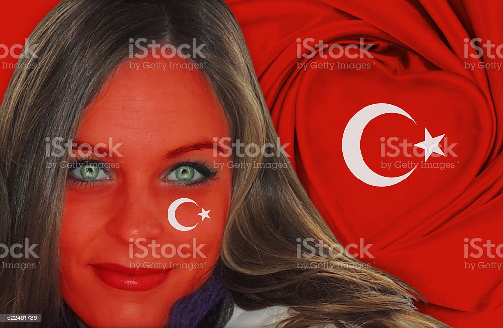 Beautiful Turkish woman in front of flag stock photo