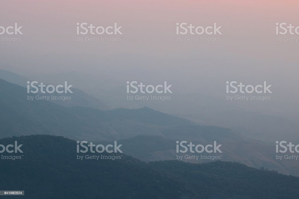 Beautiful twilight sunset landscape over mountain at Doi Inthanon , Chiang Mai , Thailand. stock photo