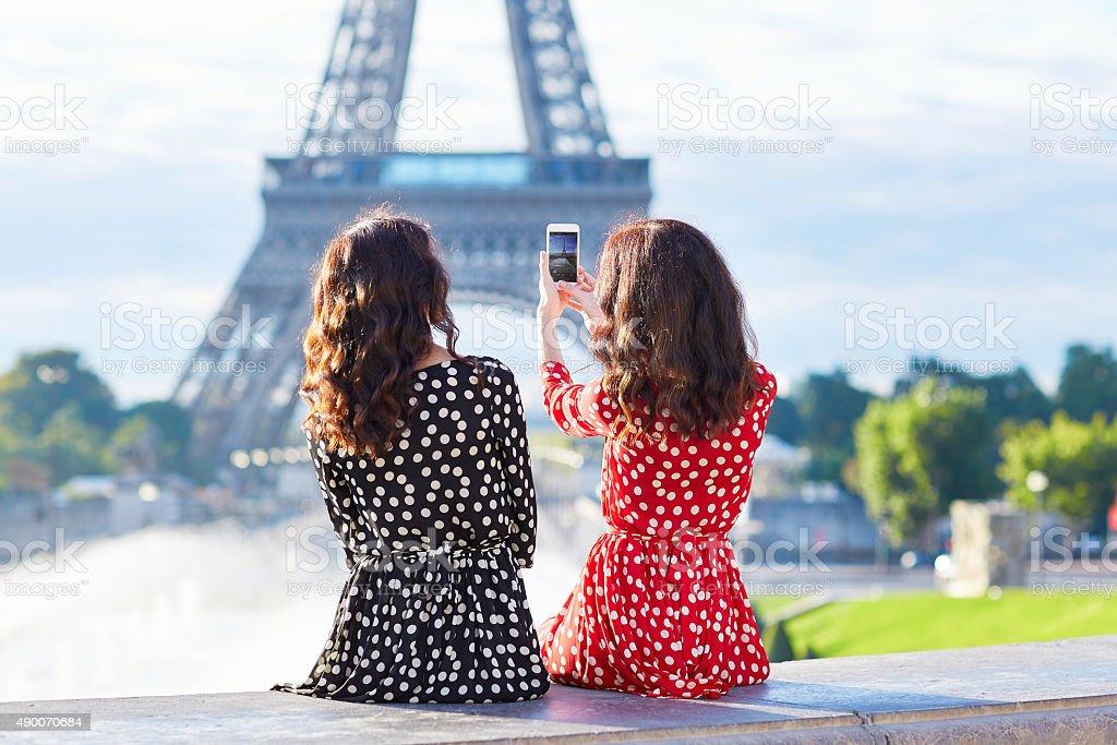 Beautiful twin sisters in Paris, France stock photo