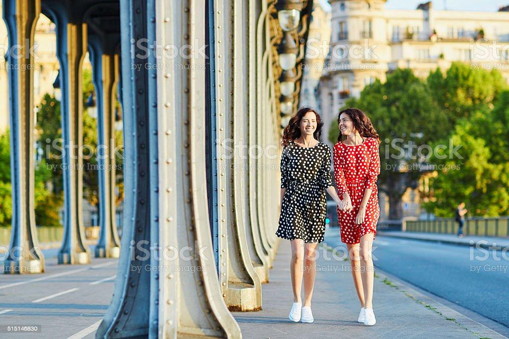 Beautiful twin sisters on the Bir Hakeim bridge in Paris stock photo