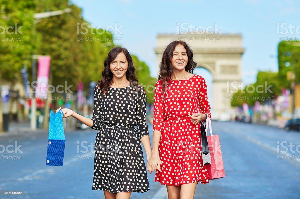Beautiful twin sisters shopping in Paris stock photo