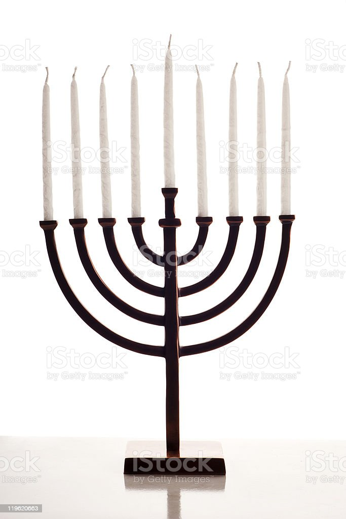 Beautiful unlit hanukkah menorah on white table. royalty-free stock photo