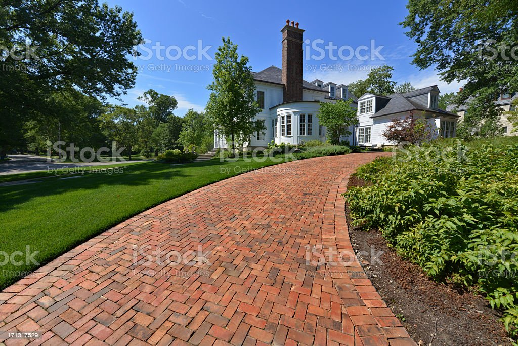 A beautiful upscale house with a nice garden stock photo