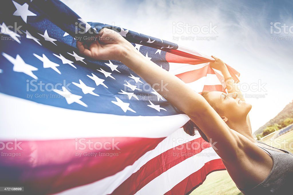 Beautiful US athlete with national flag stock photo