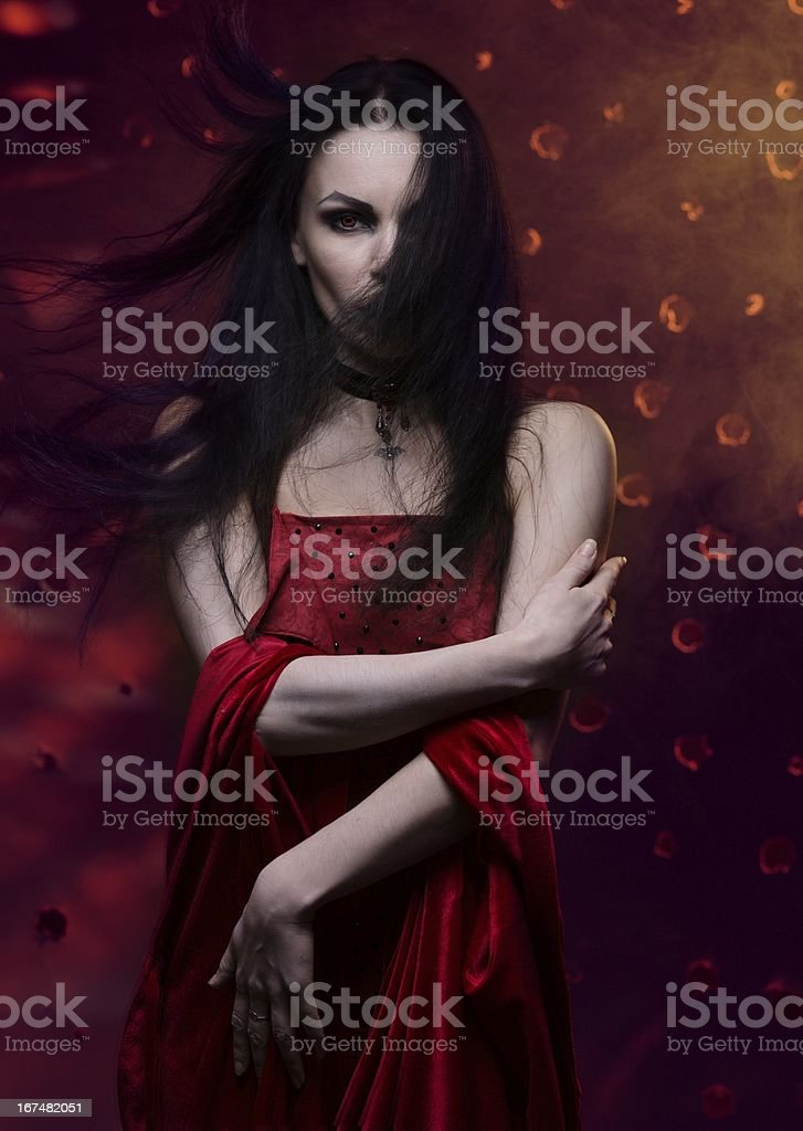 Beautiful vampire woman in red dress royalty-free stock photo