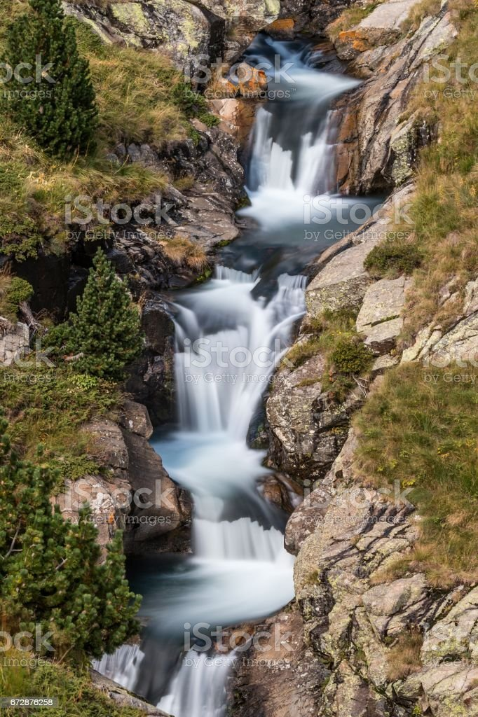 Beautiful veil cascading waterfall, mossy rocks in Pyrenees in Spain stock photo