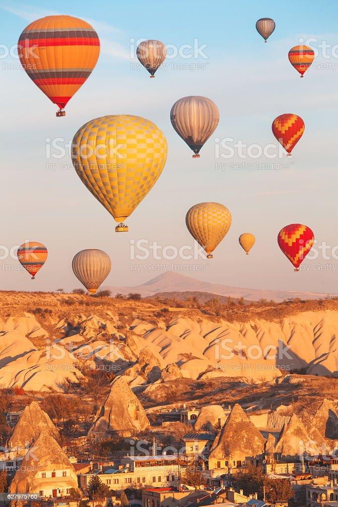 Beautiful vibrant colorful balloons in sunrise light in Cappadocia. stock photo