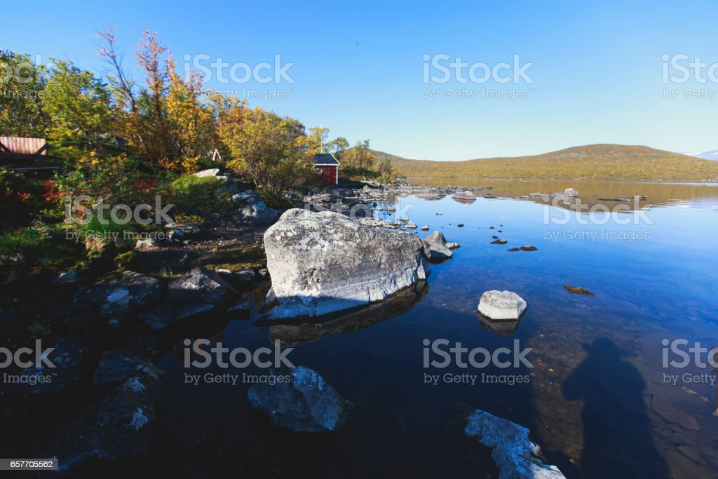 Beautiful vibrant fall autumn landscape of Abisko national park near border of Finland, Sweden and Norway, with mountains, camping place, road and forest stock photo
