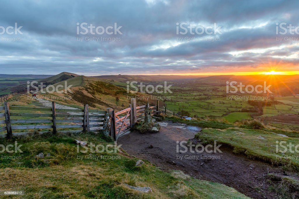Beautiful vibrant Peak District sunrise with dramatic clouds. stock photo
