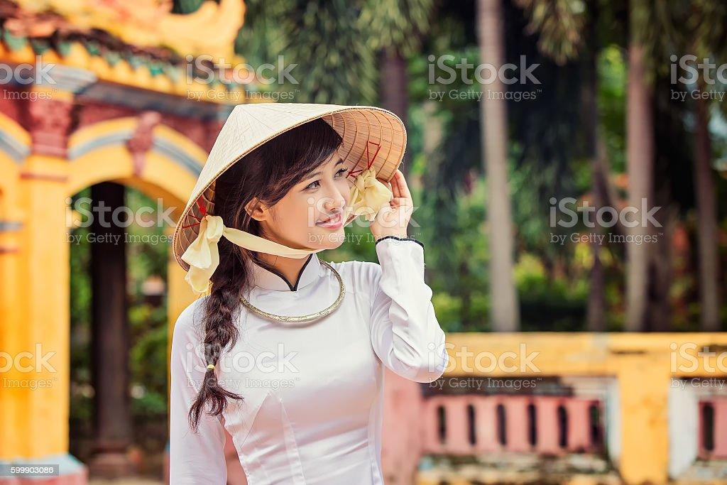 beautiful Vietnamese girl in traditional long dress or Ao Dai stock photo