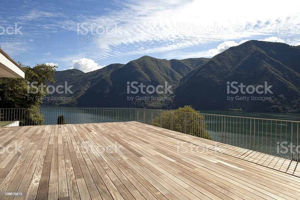 Beautiful view from a penthouse near a lake and mountains royalty-free stock photo