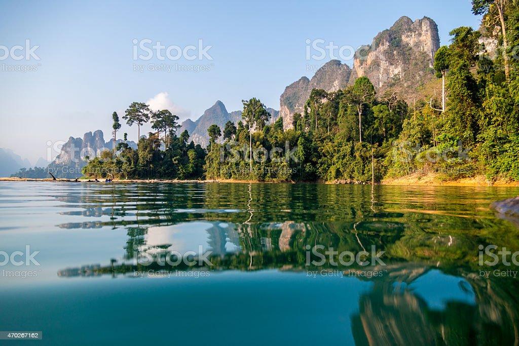Beautiful view of a lake beside a mountainside stock photo