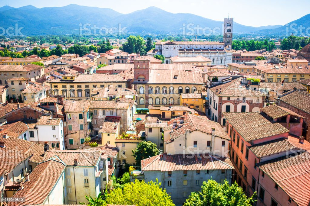 Beautiful view of ancient building with red roofs in Lucca, stock photo