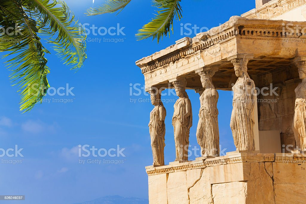 Beautiful view of Erechtheion with palm in Athens stock photo