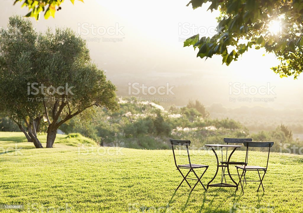 Beautiful view of lawn with empty table and chairs stock photo