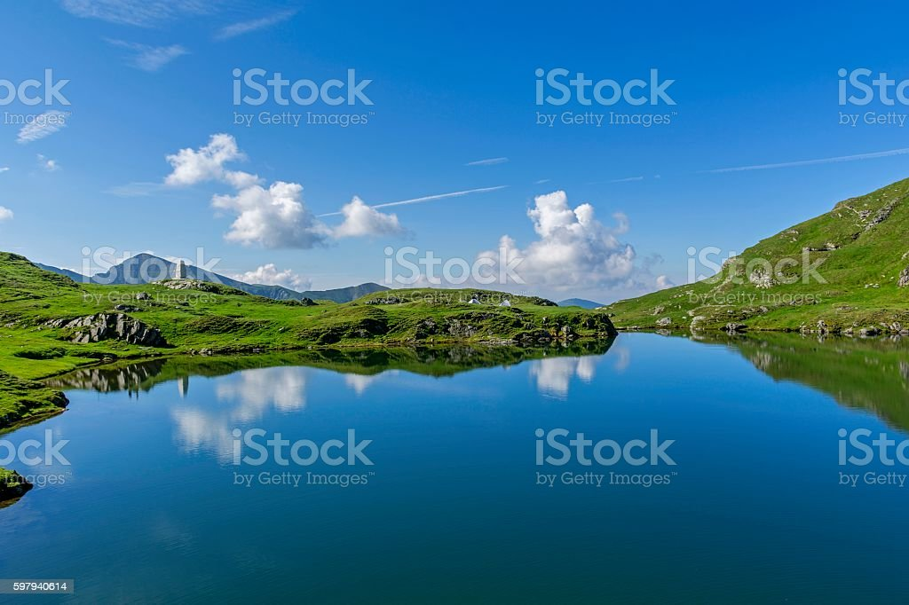 Beautiful view of  mountain lake with sky mirrored in water. stock photo