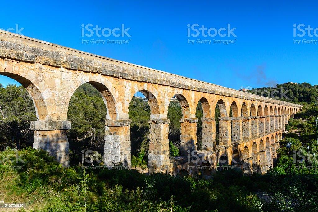 Beautiful view  of roman Aqueduct Pont del Diable Tarragona sunset stock photo