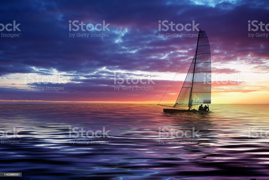 Beautiful view of sailboat in ocean during sunset royalty-free stock photo
