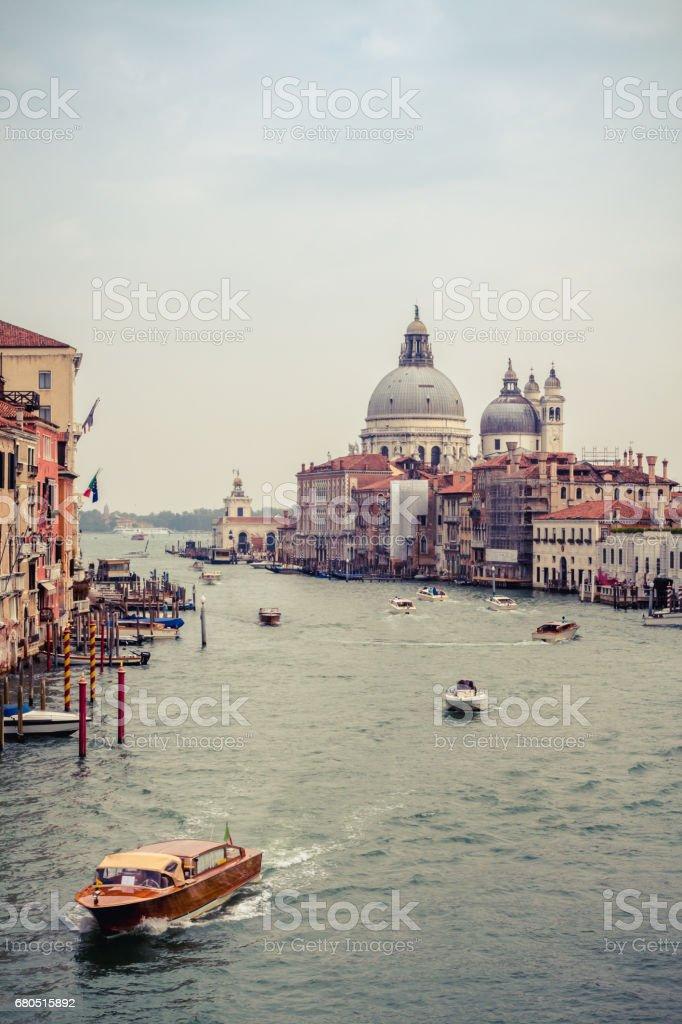 Beautiful view of the Grand Canal and the Basilica di Santa Maria della Salute taken from Ponte dell'Accademia, Venice, Italy. stock photo