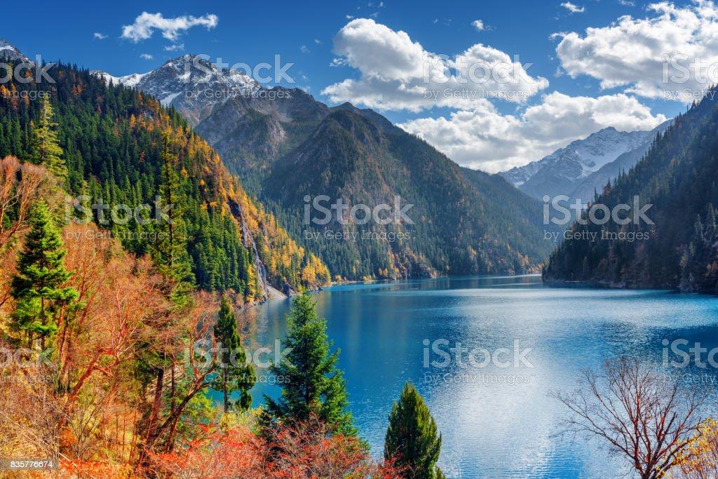 Beautiful view of the Long Lake among colorful fall woods stock photo
