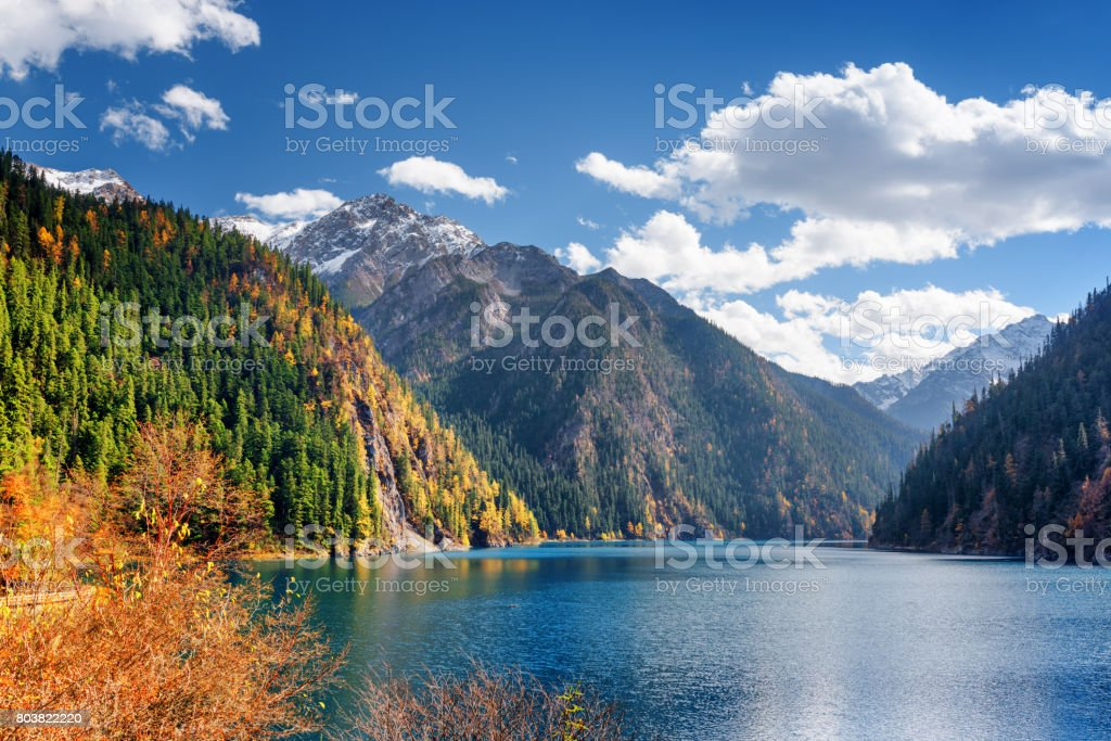 Beautiful view of the Long Lake among fall woods and mountains stock photo