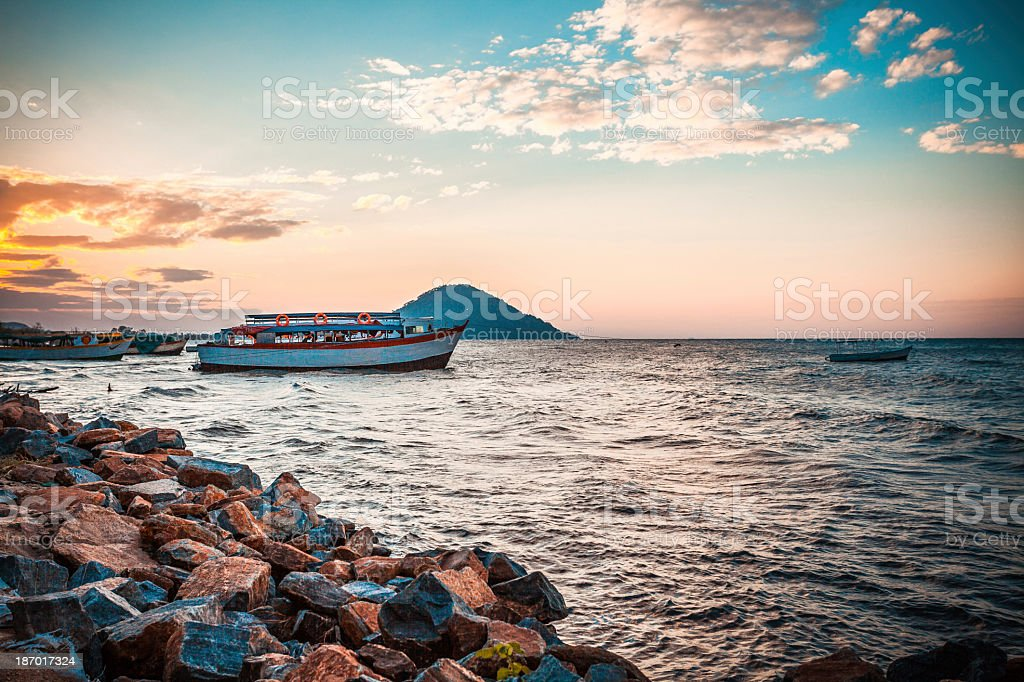 Beautiful view of the Malawi lake with a ship in the water stock photo
