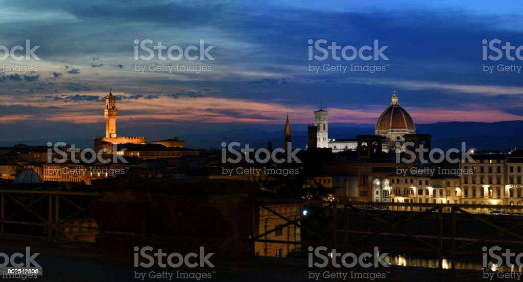 Beautiful view of the Old Palace, Giotto's Bell Tower and the Cathedral of Santa Maria del Fiore in Florence at sunset. Italy. stock photo