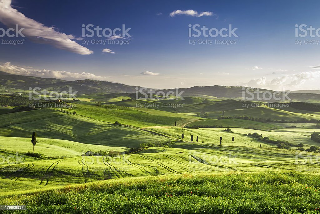 Beautiful view of the sunset over valley in Tuscany royalty-free stock photo