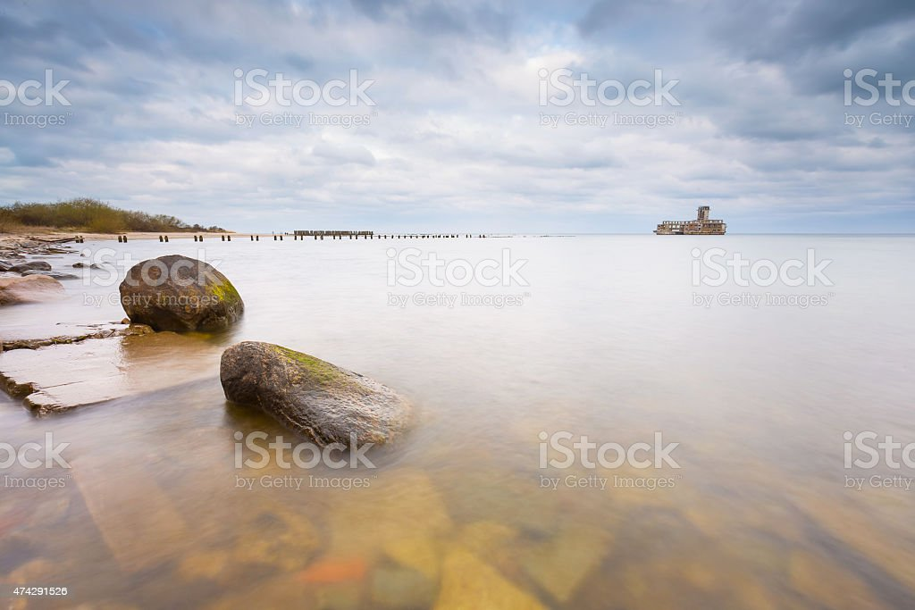 Beautiful view on Baltic sandy coast with old military buildings stock photo