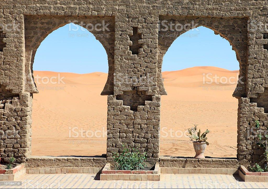 Beautiful view through arches to Erg Chebbi Dunes, Sahara, Morocco royalty-free stock photo