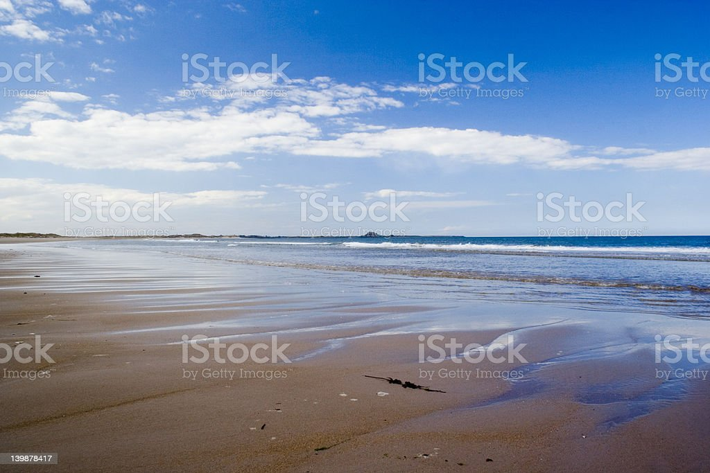 Beautiful views across deserted Ross Sands beach towards Lindisf royalty-free stock photo
