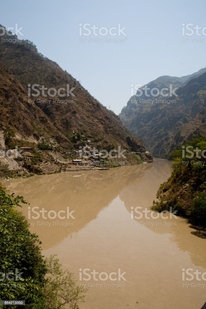 Beautiful views of the river Parvati and Himalaya mountains on the way to Manali, district Kulu in Himachal Pradesh, India. stock photo