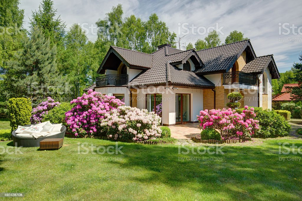 Beautiful village house with garden stock photo
