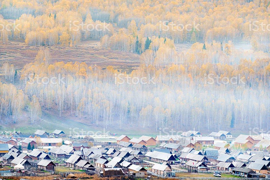 Beautiful village in morning fog, Hemu Village, Kanas, Xinjiang, China stock photo
